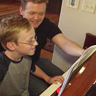 child enjoying private piano lesson in home